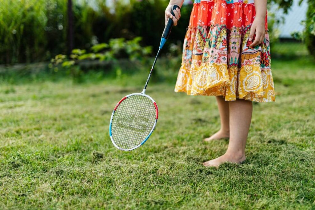 young girl exercising badminton