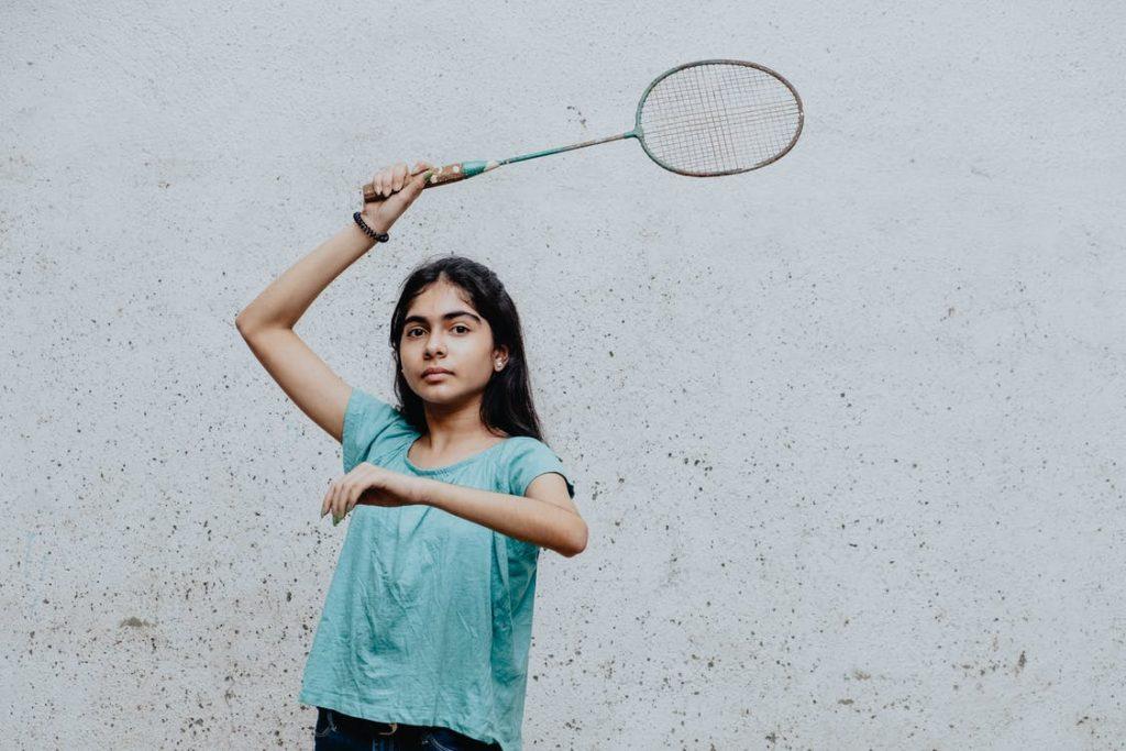 teenager playing badminton